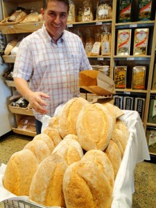 Frank Canturi with Anna's warm loaves of bread