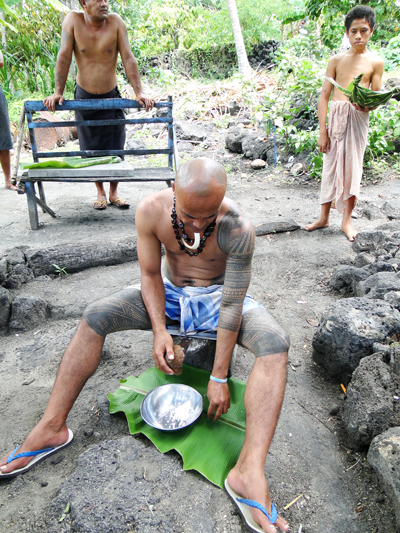 Grating fresh coconut on Manono Island