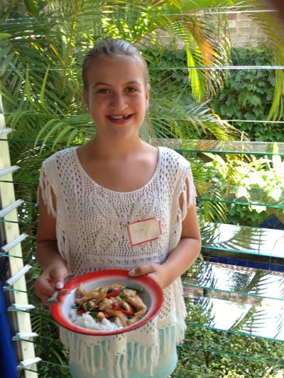 Eloise Moore, daughter of celebrity chef Michael Moore, with the stir-fry she made
