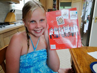 Madi, one of my students, with her recipe in the Junior Master Chef book