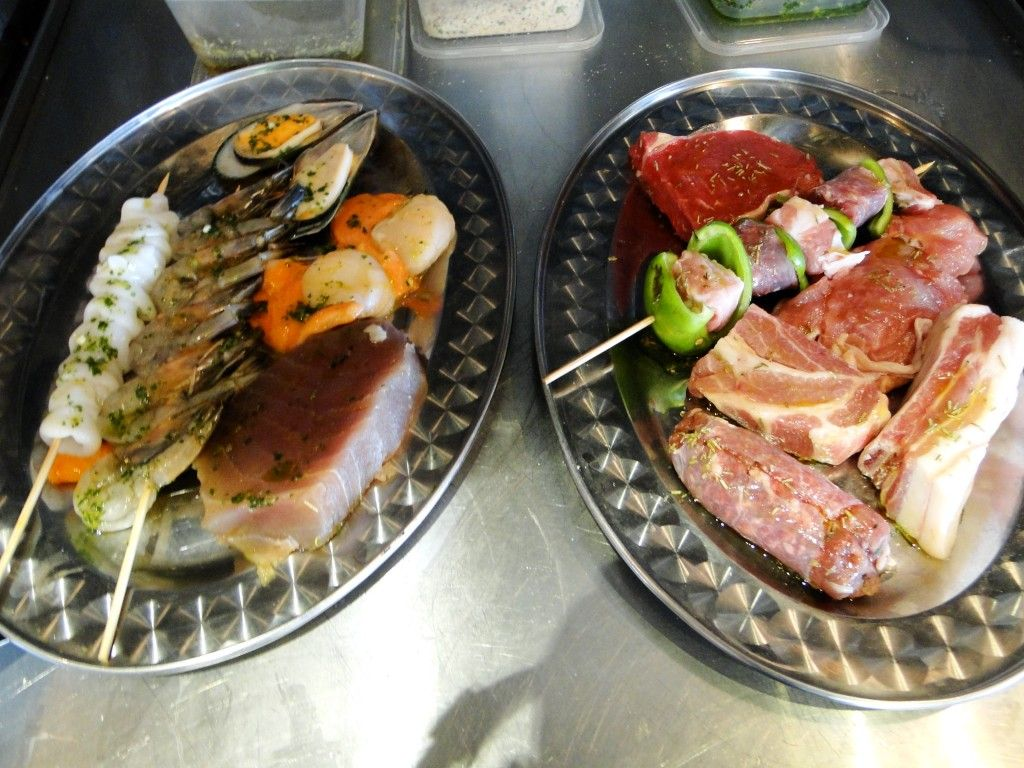 Mixed Grilled Seafood and Meat Dishes, ready for the char-grill, Francesca's
