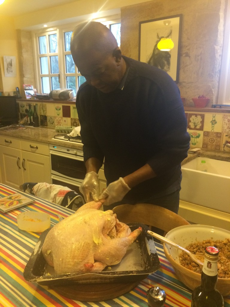 Baz stuffing the turkey early on Christmas morning