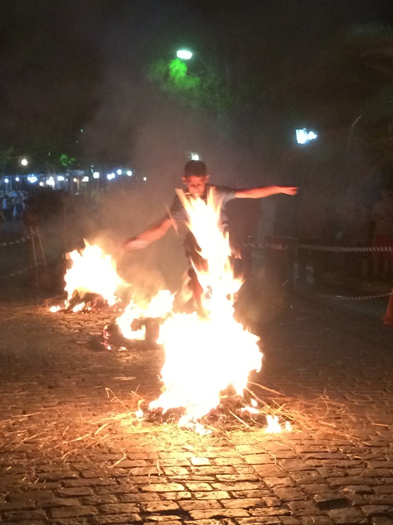 Bonfire jumping on the main street of Agia Paraskevi, St John's night