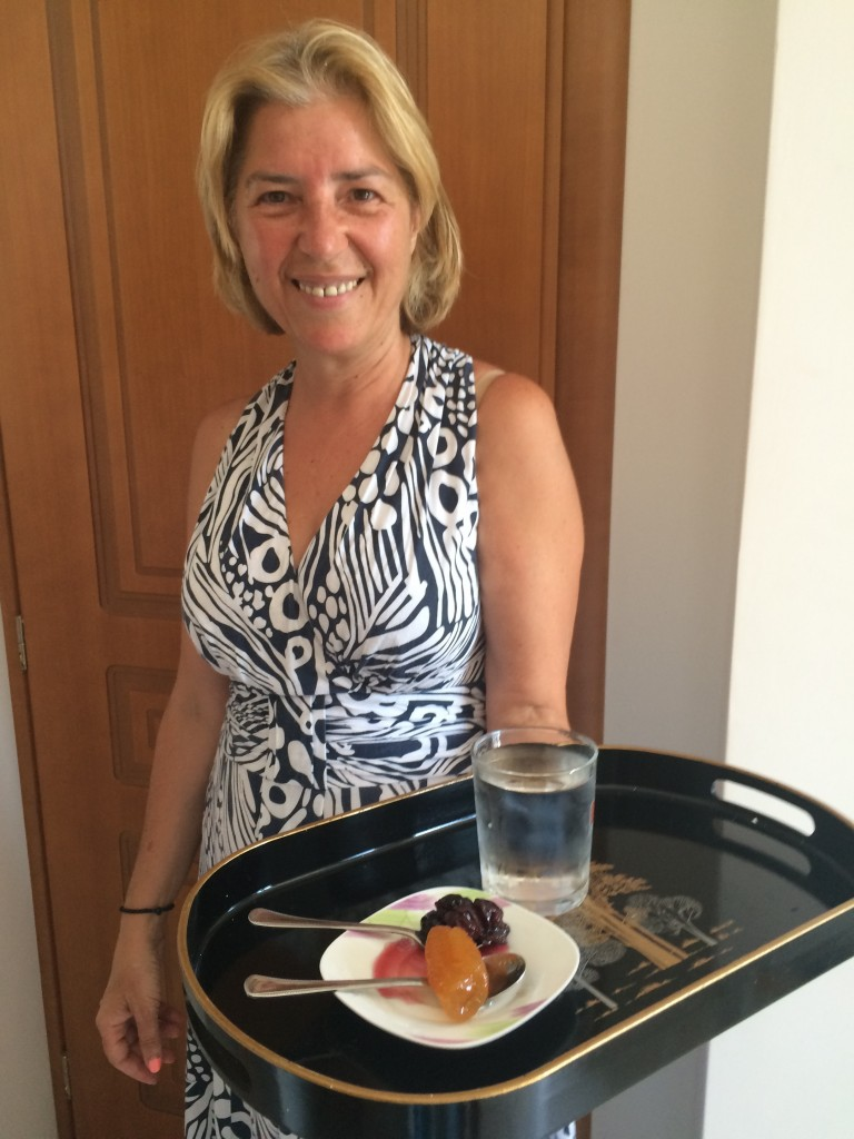 Evi Mitchell welcoming to her home in Agia Paraskevi with traditional cherry and rolled clementine spoon sweets