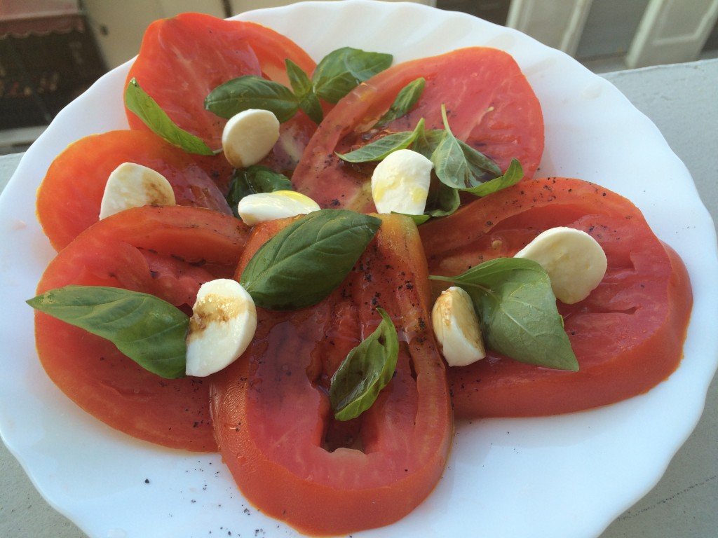 A simple luscious summer salad of tomatoes and basil