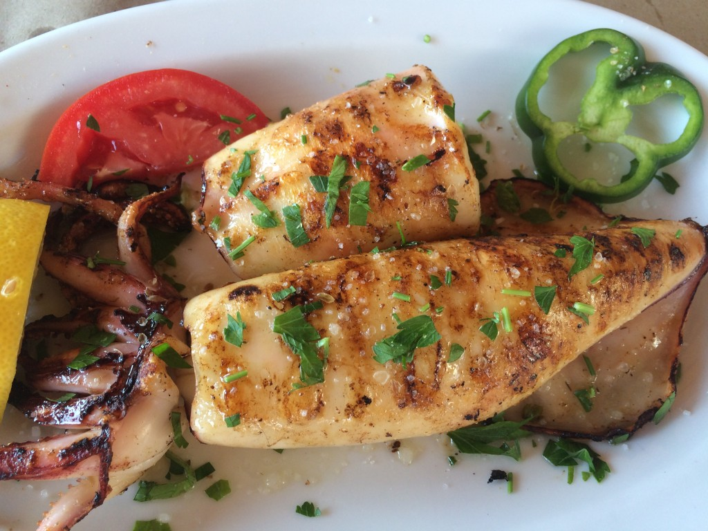 Whole grilled calamari, just one of many delicious seafood dishes at Saloutso Tavern