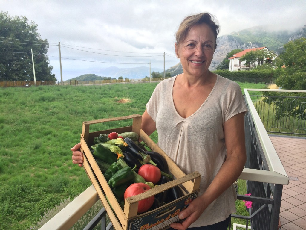 Filomena with a box of her home-grown veggies