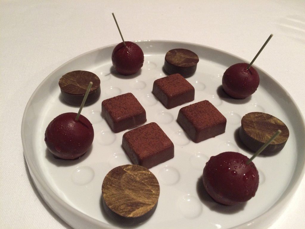 Vignola (chocolate covered cherries) and assorted petits fours