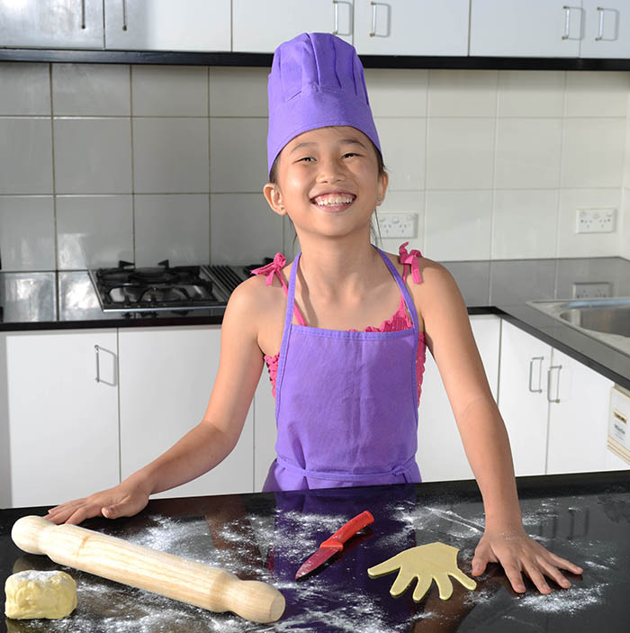 Need a hand? Mini Chef Zoe with one of her pastry cut outs